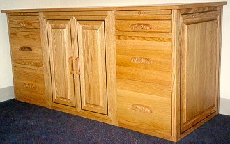 Red oak credenza with a purpleheart border inlay.